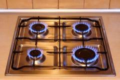 Fogão de gás da cozinha com as flamas do incêndio Fotografia de Stock Royalty Free