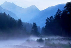 Fog. Over the river. Forest and high mountains Royalty Free Stock Images