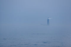 Fog. A lighthouse in dense fog Stock Photo