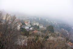 Fog above Milies village on mountain Pelion Stock Images