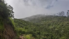 Fog above mountain. Fog above cusp of a mountain going down to the village Royalty Free Stock Photography