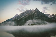 Fog above mountain lake Royalty Free Stock Images