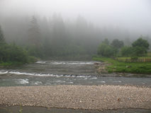 Fog. Above the mountain river, the forest in Royalty Free Stock Images