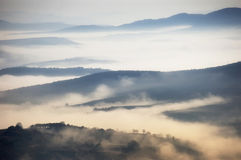 Fog above the mountains. On a misty morning Royalty Free Stock Photography