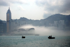 Fog around building. In Victoria Harbour, Hong Kong royalty free stock photography