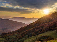 Fog around the mountain top at sunset Royalty Free Stock Photo