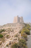 Fog around the Tower of Roldan. Coastal watchtower on the south coast of ptain at the Mesa Roldan Stock Images