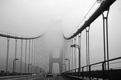 Fog atop the Golden Gate Bridge in San Francisco Royalty Free Stock Photos