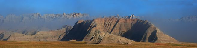 Fog in the Badlands panorama. South Dakota Badlands with early morning fog rolling in Royalty Free Stock Photo