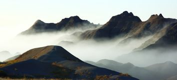 Fog in the Badlands. South Dakota Badlands with early morning fog rolling in Royalty Free Stock Image