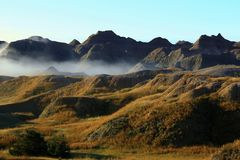 Fog in the Badlands. South Dakota Badlands with early morning fog rolling in Royalty Free Stock Photo