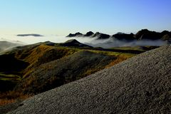 Fog in the Badlands. South Dakota Badlands with early morning fog rolling in Royalty Free Stock Photos