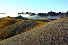 Fog in the Badlands. South Dakota Badlands with early morning fog rolling in Stock Photos