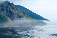 Fog on the Baikal spring sunrise Stock Photo