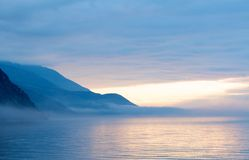 Fog on the Baikal spring sunrise Royalty Free Stock Images