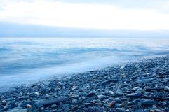 Fog on the Baikal spring sunrise  stony beach Stock Images