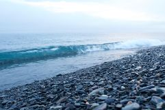 Fog on the Baikal spring sunrise stony beach Royalty Free Stock Images