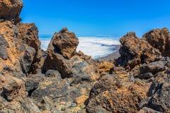 Fog Bank Behind Volcanic Rocks Royalty Free Stock Photos