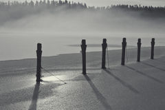 Fog Bank Over the Icy Lake Stock Images
