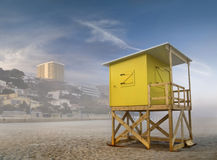 Fog on the Beach. Beach scene taken in Benidorm, Costa Blanca, Spain, in a foggy day, with a yellow lifeguard stand on the foregroung Royalty Free Stock Image