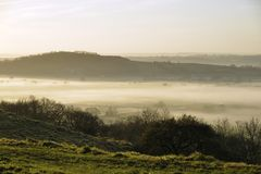 Fog below Dundon Hayes Hill. Polden Hills, Somerset Royalty Free Stock Photos