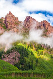 Fog Below Jagged, Red Peaks Royalty Free Stock Photography