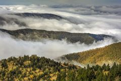 Fog On The Blue Ridge Parkway. Early morning fog settles into the valleys of the mountains along the Blue Ridge Parkway in Western North Carolina on a crisp stock image