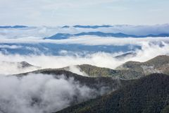 Fog On The Blue Ridge Parkway. Early morning fog settles into the valleys of the mountains along the Blue Ridge Parkway in Western North Carolina on a crisp stock photos