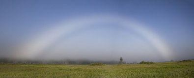 Fog bow (white rainbow) panorama Stock Photos