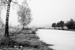 Fog, calm, river. Fog, morning, sitting in mist on bench. Black and white photo to capture contrast.stones at the river,fog, calm, man,river royalty free stock photo