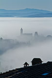 Fog and church Royalty Free Stock Image