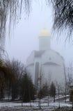 Fog and church Stock Photos