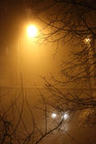 Fog in the city. The city at night in the fog, a lantern in the fog Royalty Free Stock Images