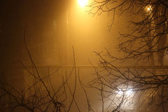 Fog in the city. The city at night in the fog, a lantern in the fog Royalty Free Stock Photo