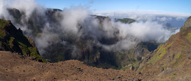 Fog climbing mountains, Madeira. Fog and clouds climbing mountain walls at Pico do Areeiro. Madeira, Portugal Stock Photography