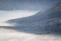 White fog at the bottom of mountain Royalty Free Stock Image