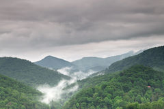 Fog and cloud mountain valley landscape Stock Photos