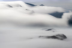 Fog and cloud mountain valley landscape Stock Images