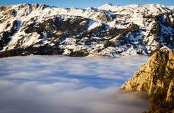 Fog and cloud snow mountain valley landscape. View of Aramo Mountain, Asturias, Spain royalty free stock photo