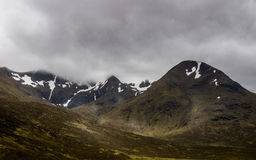 Fog clouds hanging over the Glencoe mountains. Royalty Free Stock Photos