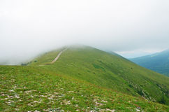 Fog and clouds on the mountain Royalty Free Stock Image