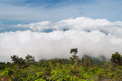 Fog and clouds over Mountain. Volcano Mount Merapi. Stock Images