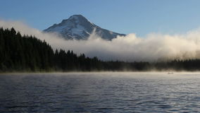Fog and Clouds Over Trillium Lake with Mount Hood in Oregon One Early Morning at Sunrise HD Video 1080p stock video
