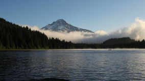 Fog and Clouds Over Trillium Lake with Mount Hood in Oregon One Early Morning at Sunrise Panning HD Video 1080p stock footage