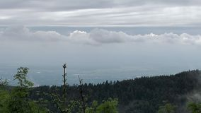 Fog and clouds over the valley of Rhine. A view from a high point in mountains Schwarzwald. stock footage