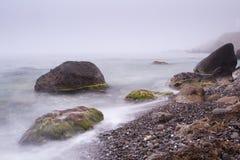 Fog coast Stock Images