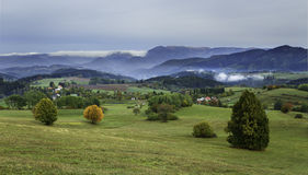 fog and colored trees - autumn in Slovakia Royalty Free Stock Photo