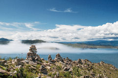 Fog is coming. Coast of Baikal lake, fog is coming fast Royalty Free Stock Photo