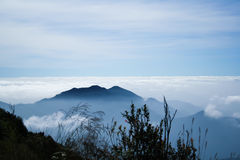 Fog cover on the mountain and bring cloudy. Fog cover on the mountain Stock Photography