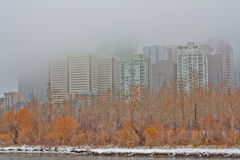 Fog Covered Cityscape of Calgary. Foggy cityscape of Calgary with the Bow River in the foreground Royalty Free Stock Photography